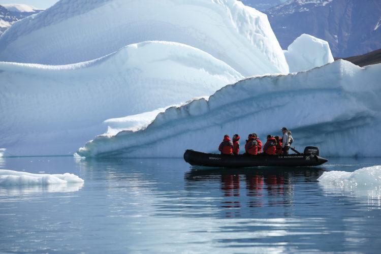 Zodiac cruise amidst icebergs
